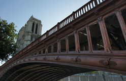 Notre Dame on a bridge Stock Images