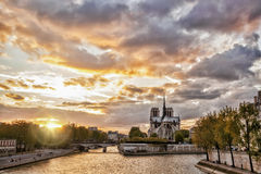 Notre Dame cathedral against sunset in Paris, France Stock Photos