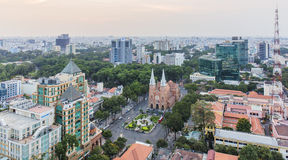 Notre Dame Cathedral amd city center in sunset. Ho Chi Minh city. Ho Chi Minh City has the most dynamic economy in Vietnam Stock Images