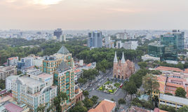 Notre Dame Cathedral amd city center in sunset. Ho Chi Minh city. Ho Chi Minh City has the most dynamic economy in Vietnam Royalty Free Stock Image