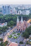Notre Dame Cathedral amd city center in sunset. Ho Chi Minh city. Ho Chi Minh City has the most dynamic economy in Vietnam Stock Photography