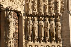 Notre Dame Cathedral Apostels. Notre Dame de Paris, France. View of the carved apostles royalty free stock photo