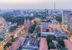Notre Dame Cathedral and city center in sunset. Ho Chi Minh city. Ho Chi Minh City has the most dynamic economy in Vietnam Stock Photos