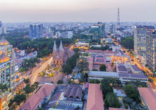 Notre Dame Cathedral and city center in sunset. Ho Chi Minh city. Ho Chi Minh City has the most dynamic economy in Vietnam Royalty Free Stock Photo