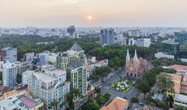 Notre Dame Cathedral and city in sunset. Ho Chi Minh city. Ho Chi Minh City has the most dynamic economy in Vietnam Stock Photo