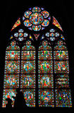 Notre Dame cathedral color glass window and statue. Notre Dame cathedral, inside color glass windows suggestive view Royalty Free Stock Photo