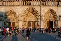 Notre-Dame Cathedral Front with Tourists stock photos