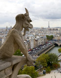 Notre Dame Cathedral Gargoyle over Paris Royalty Free Stock Photo
