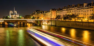Notre Dame Cathedral and Ile Saint Louis illuminated, Paris, France Royalty Free Stock Photography