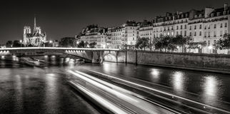 Notre Dame Cathedral and Ile Saint Louis at night Black & White, Paris, France Royalty Free Stock Photo