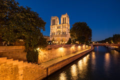 Notre Dame Cathedral illuminated at twilight. Summer in Paris, France Stock Images