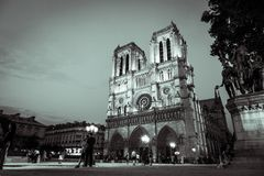 Notre Dame Cathedral lit up at night in black and white stock photography