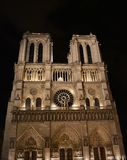 Notre Dame Cathedral at midnight. Facade, towers, rose window, archs and statues. Paris, France. stock photo
