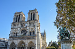 Notre Dame cathedral next to the river of Paris with boats and buildings summertime. France Stock Photo