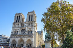 Notre Dame cathedral next to the river of Paris with boats and buildings summertime. River of Paris with boats and buildings summertime, France with the Royalty Free Stock Photography
