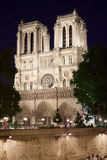 Notre Dame cathedral at night with people Royalty Free Stock Images