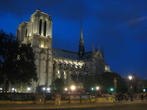 Notre-Dame Cathedral at Night. The side view of the Notre-Dame Cathedral in Paris, France at night. The  side view allows the flying buttresses to be seen Royalty Free Stock Photography