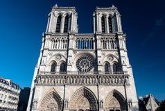 Notre Dame Cathedral, Paris. PARIS - April 17, 2015: The view on the famous french landmark Notre Dame de Paris through the winter park on April 17, 2015 in Stock Photos