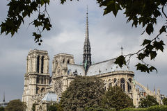 Notre Dame cathedral, paris, with cloudy sky backdrop Royalty Free Stock Photos