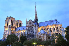 Notre Dame Cathedral in Paris at dusk Stock Images