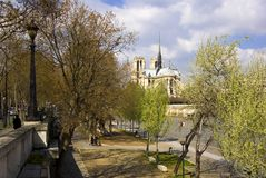 Notre Dame Cathedral, Paris, France. Notre Dame Cathedral and the Left Bank of the River Seine on a sunny Spring day Royalty Free Stock Photography