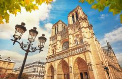 Notre-Dame Cathedral in Paris France with Golden Light Rays. Notre Dame in Paris France. Notre Dame Cathedral with Golden Light Rays and Beautiful Gothic royalty free stock photo