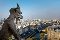 Notre Dame Cathedral, Paris. Paris, France. November 14, 2005. Gargoyles overlooking the city Royalty Free Stock Photography