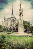 Notre Dame Cathedral in Paris, France. Square Jean XXIII. Vintage Royalty Free Stock Photo