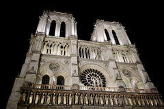 Notre Dame cathedral in Paris illuminated at night Royalty Free Stock Photography