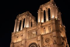 Notre Dame Cathedral in Paris and its lighting at night stock image
