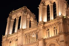 Notre Dame Cathedral in Paris and its lighting at night royalty free stock images