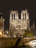 Notre Dame Cathedral in Paris At Night. Unesco World Heritage Site Notre Dame Cathedral in Paris At Night with Sein river Stock Photo