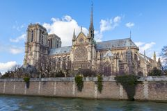 Notre Dame Cathedral Paris, side elevation. Notre Dame Cathedral in Paris. Springtime view of the side elevation with spire and rear flying buttresses, taken stock images