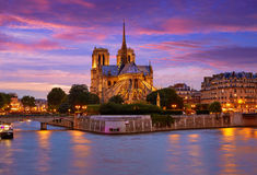 Notre Dame cathedral Paris sunset at Seine Stock Photos