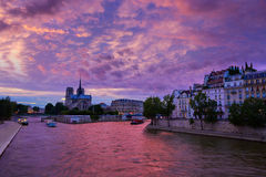 Notre Dame cathedral Paris sunset at Seine Royalty Free Stock Photo