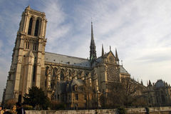 Notre Dame Cathedral from the river bank. Notre Dame Cathedral on a sunny Valentines Day from the river bank Royalty Free Stock Photos