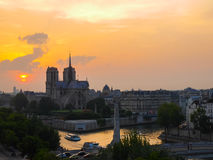 Notre Dame cathedral and the river Seine in Paris at sunset Stock Photo