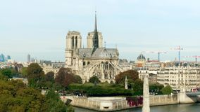 Notre-Dame Cathedral and the Seine river embankment on sunny autumn day Royalty Free Stock Photography