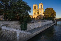 Notre Dame Cathedral and Seine River at sunset. Paris, France Royalty Free Stock Photos