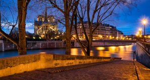 Notre Dame Cathedral and Seine River at twilight, Paris, France Stock Photography