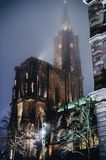Notre-Dame Cathedral in Strasbourg,  at dusk. Notre-Dame Cathedral in Strasbourg, France at night with magic Christmas colours light on a mist evening Royalty Free Stock Photography