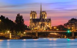 The Notre Dame Cathedral at sunset , Paris, France. The Notre Dame cahedral at sunset. It is historic Catholic cathedral, one of the most visited monuments in Stock Photo