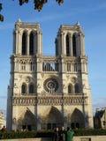 Notre Dame Cathedral, Paris, France, front view. Notre Dame Cathedral and tourists taking picture in front of it, Paris, France Stock Images