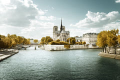 Notre Dame church in Paris and autumn sunny day Royalty Free Stock Images