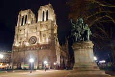 Notre Dame church and statue in Paris Royalty Free Stock Image