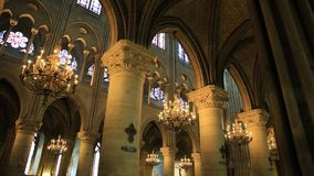 Notre Dame colonnade. PARIS, FRANCE - JULY 2, 2017: pov walking in interior colonnade of Notre Dame of Paris, gothic church left side nave with candelabrum stock footage
