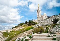 Notre-Dame de la Garde basilica. Notre-Dame de la Garde (literally Our Lady of the Guard), is a basilica in Marseille, France. This ornate Neo-Byzantine church Royalty Free Stock Images