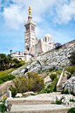 Notre-Dame de la Garde basilica. Notre-Dame de la Garde (literally Our Lady of the Guard), is a basilica in Marseille, France. This ornate Neo-Byzantine church Royalty Free Stock Photos