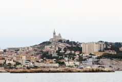 Notre Dame de la Garde, Marseille, France. Marseille's iconic figure, Notre-Dame de la Garde or La Bonne Mère, watches over sailors, fishermen and the entire Royalty Free Stock Images