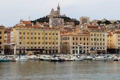 Notre Dame de la Garde and Marseille port, France. Marseille's iconic figure, Notre-Dame de la Garde or La Bonne Mère watches over sailors, fishermen and the Royalty Free Stock Image